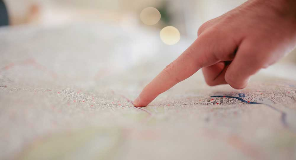 Person pointing at a map