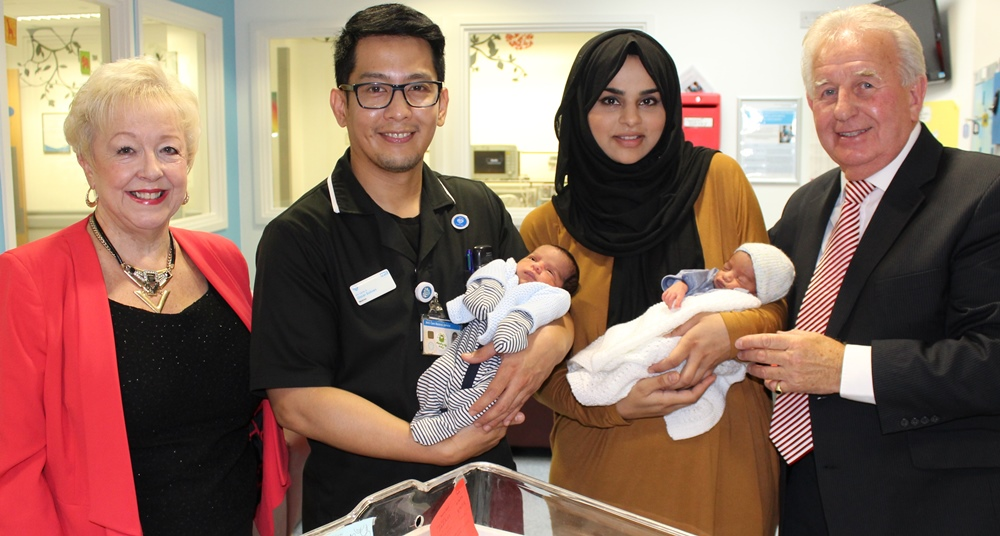 Pictured are Bunny and Brian Eagling with Oscar Soliven, NICU Matron, the twins and mum Shama Akram