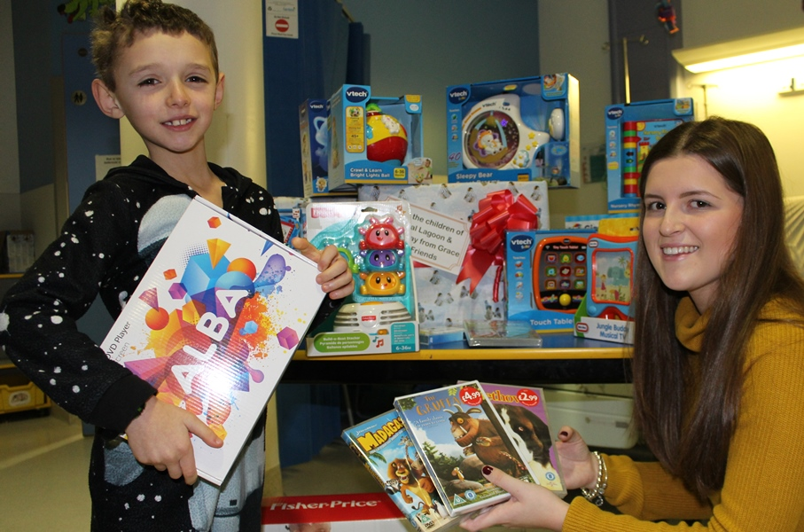 Grace with eight-year-old Michael Charalambous, one of the first young patients to benefit from the new toys.