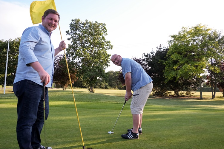 Pictured is Graeme (right, teeing off) with Dan Young, service manager for surgery who helped organise the event