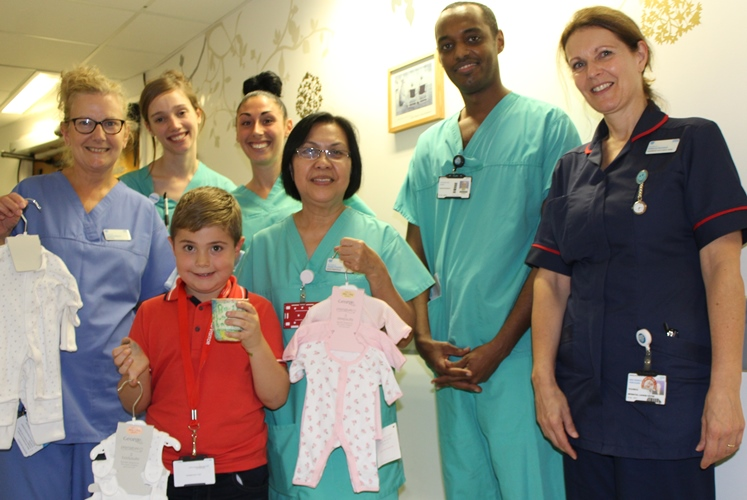 Pictured is Henry with some of our NICU nurses, including Susanne, and his donations