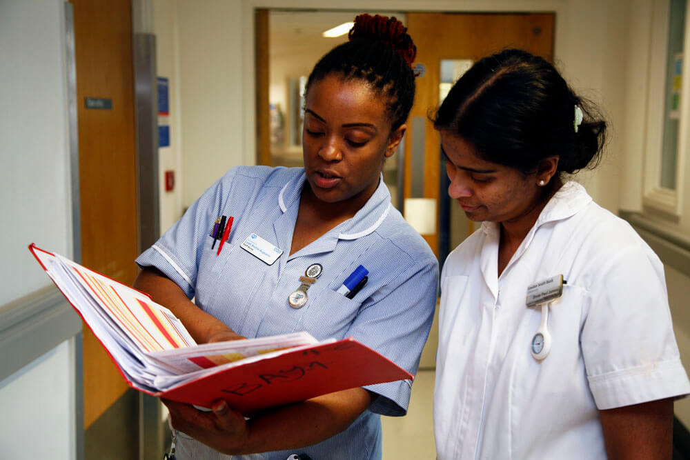 nurses looking at notes