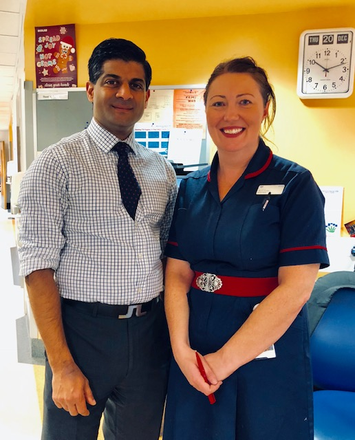 consultant and nurse smiling