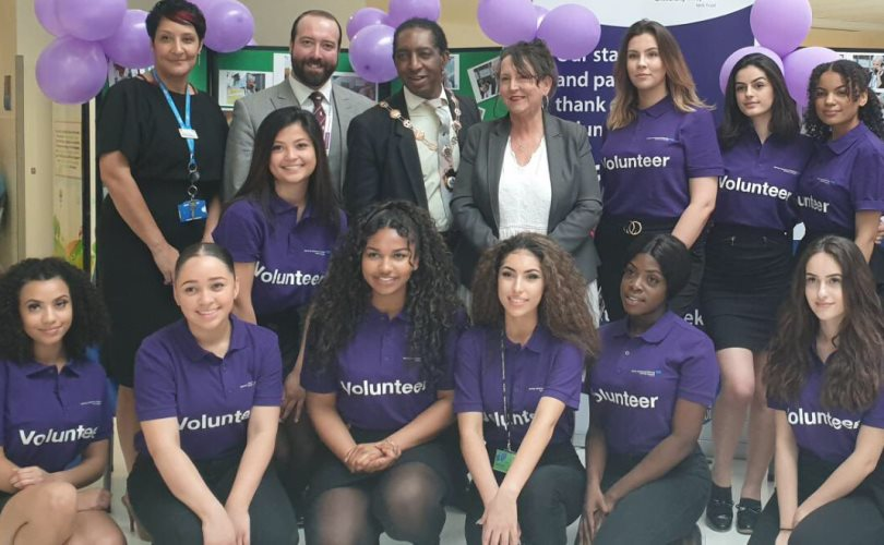 Students from The Palmer Catholic Academy, Ilford with Antoinette Webber, Voluntary Servcies Manager, Councillor Jason Frost, the Mayor, and Councillor Lynda Rice